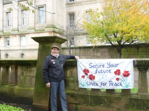 "Gordon Nash with the ""Secure Your Future"" banner"